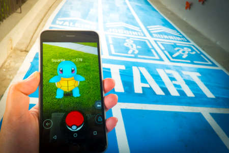 BANGKOK, THAILAND - August 12,2016: Pokemon Go gameplay screenshot on the phone. Pokemon Go is a location-based augmented reality mobile game.