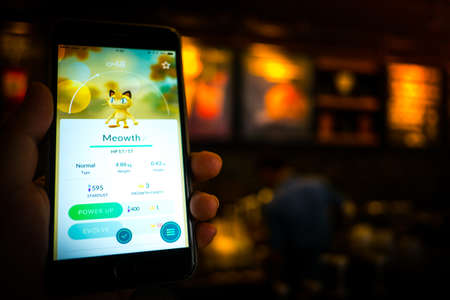 gameplay: BANGKOK, THAILAND - August 12,2016: Pokemon Go gameplay screenshot on the phone. Pokemon Go is a location-based augmented reality mobile game,Playing in cafe