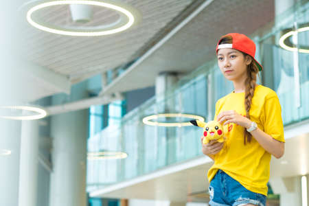 real world: BANGKOK, THAILAND - August 14,2016: Pokemon Go mobile game app on smart phone gadget with play screen catching cartoon in real world using gps technology ,Lighting with sun flare Editorial