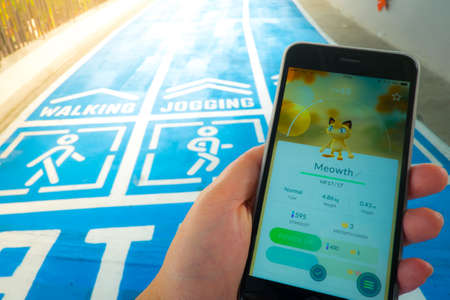 gameplay: BANGKOK, THAILAND – August 12,2016: Pokemon Go gameplay screenshot on the phone. Pokemon Go is a location-based augmented reality mobile game.