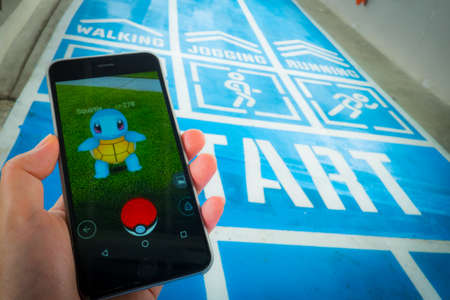 gameplay: BANGKOK, THAILAND - August 12,2016: Pokemon Go gameplay screenshot on the phone. Pokemon Go is a location-based augmented reality mobile game.