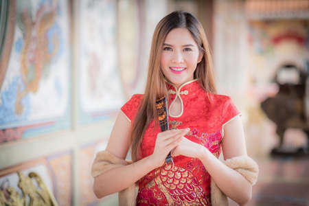 Asian Chinese woman in Traditional Chinese,by background ambience China .