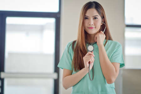 beautiful womb: Beautiful smiling doctor woman over  hospital background