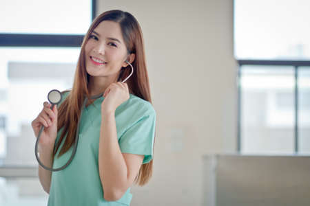 Beautiful smiling doctor woman over  hospital background