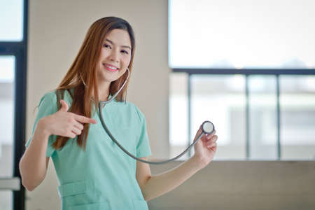 beautiful womb: Doctor holding a stethescope Stock Photo