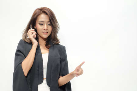 hear business call: Portrait beautiful asian woman standing , showing blank area for sign or copyspace On the white background Stock Photo