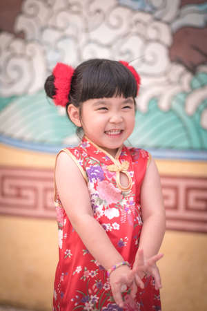 provided: Cute girl wearing red Chinese suit,Photos provided by background ambience China .