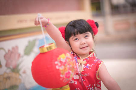 ambience: Asian Chinese girl  in Traditional Chinese  hold red  paper lanterns,Photos provided by background ambience China .
