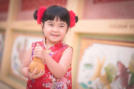 Asian Chinese girl in Traditional Chinese hold calabash,Photos provided by background ambience China .