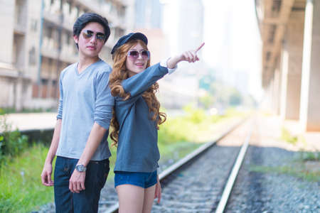 beautiful womb: Couples are traveling together, wearing sunglasses , on the tracks . Stock Photo