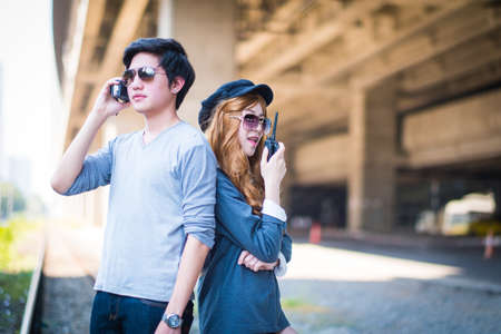 transceiver: Men and women are communicating with TRANSCEIVER.,Background building cement Stock Photo