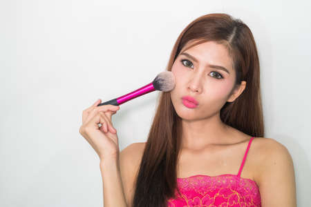 beautiful womb: Makeup. Make-up Face. Big Make up brush. Makeup applying concept. Beautiful fashion model girl face closeup. Skin tone. Facial powder,Isolated background.