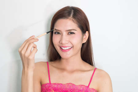 beautiful womb: beautiful young woman comb her eyebrows with brush
