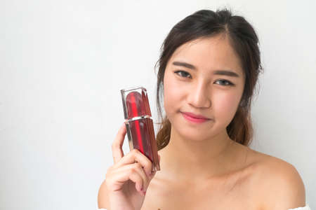 doctor holding gift: beautiful woman applying cosmetic cream, The red packets