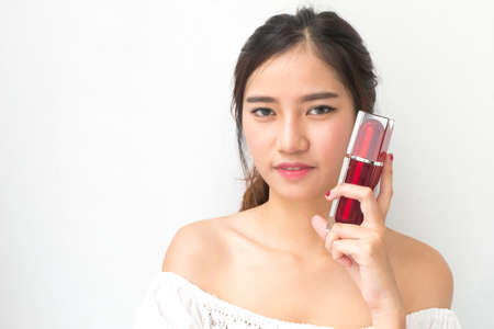 beautiful womb: beautiful woman applying cosmetic cream, The red packets