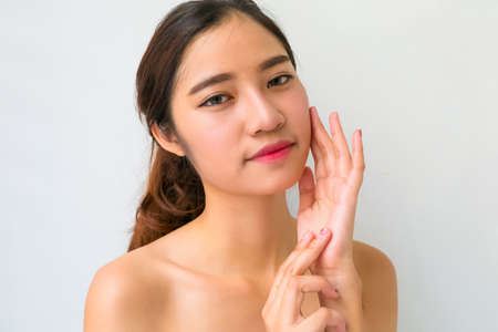 beautiful womb: Portrait of a beautiful female model on white background Stock Photo