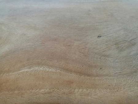 Close up of old wooden table surface. There are uneven color (pale on top) and many tiny scratched lines on pale area. Use as background, texture, etc.
