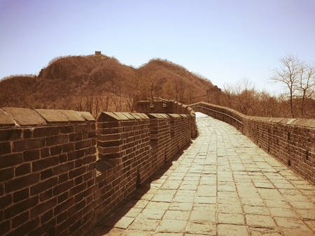 Hushan Great Wall in vintage style. It is the most eastern part of China Great Wall and located on Tiger mountain, Dandong, Liaoning; beside China-North Korea border. Top and right-bottom copy spaces. Stock Photo