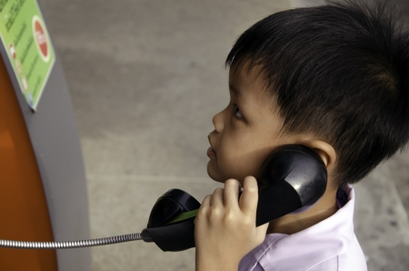 Boy talking on the phone accidentally