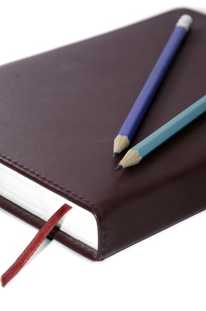 Wooden pencil on the book