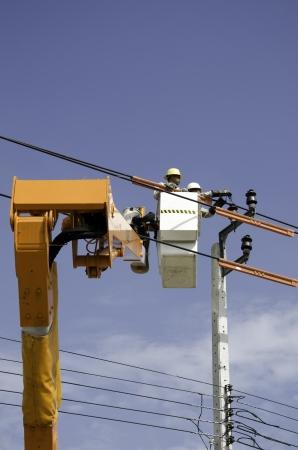 splice: The crane technicians are repairing wires. Stock Photo