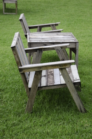 Wooden chairs in the lawn.