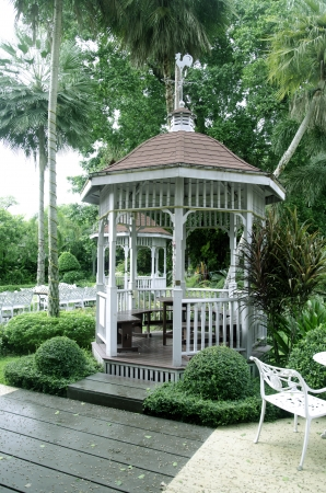 White wood gazebo in the garden.