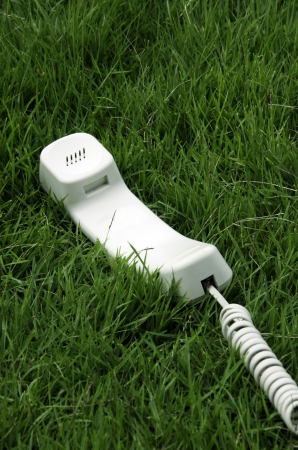 White desktop phone in the field. Stock Photo - 21396787
