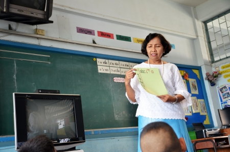 Female teacher was teaching the class page  Stock Photo - 22625860