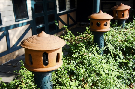 ceramicist: Lamp made  of pottery in front of the restaurant