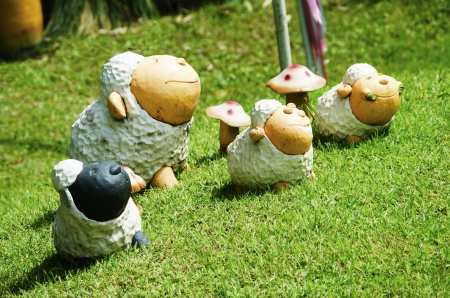 Statues of sheep family decoration in the garden  photo
