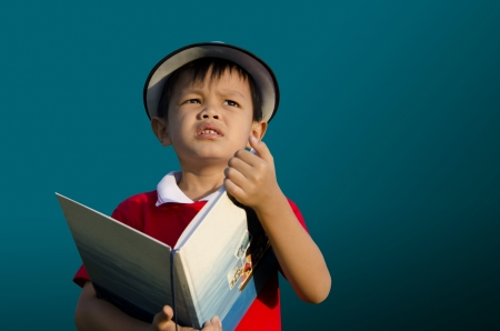 thoroughly: Children reading a book with a dark background