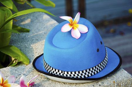 Plumeria flower on a blue hat