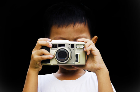 photography session: Children wearing white photography using older cameras Stock Photo