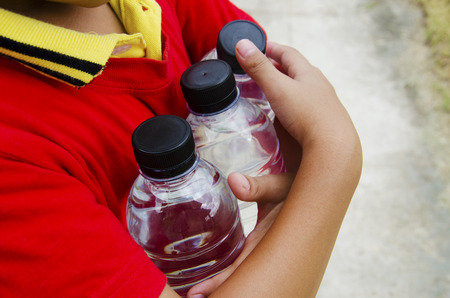 Bottle of drinking water in the arms of boys  photo