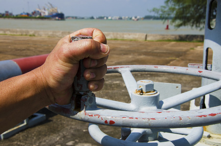 hand industrial use in the ocean as a backdrop. Stock Photo