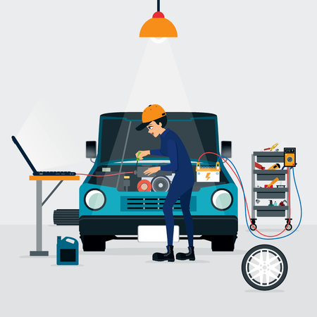 computer repairing: Auto mechanic repairing a car with the engine running and the computer.