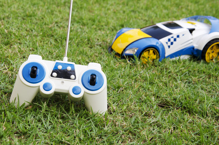 Car radio with a lawn in the background. Foto de archivo