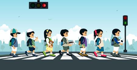 신호등이있는 횡단 보도를 걷는 학생.