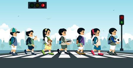 Students walking on a crosswalk with a traffic light.