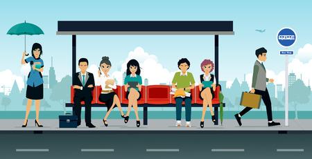 직원들과 사람들이 버스 정류장에 앉아있었습니다.
