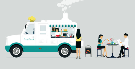 who: Food truck selling food to customers who have a gray background.
