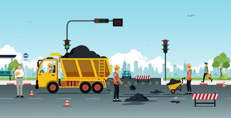 Werknemers repareren wegdekken met verkeerslichten.