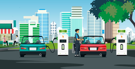 The electric car is charging the building with a backdrop. Banco de Imagens - 98913516