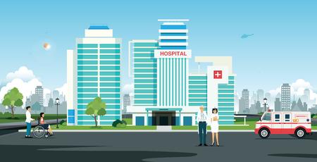 Lekarz i pielęgniarka przed szpitalem z karetką