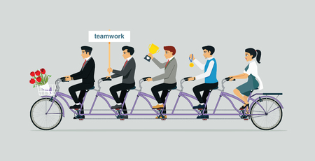 Teams of business people share a spinning Tandem bike ride with trophies.