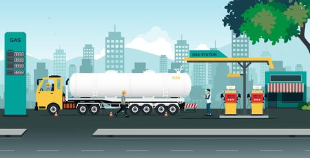 The truck is transferring oil at a station that is inspected by employees.