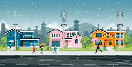 Persone e bambini in età scolare stanno tornando a casa sotto la pioggia.