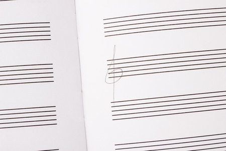sheetmusic: close up of paper with note bars and key