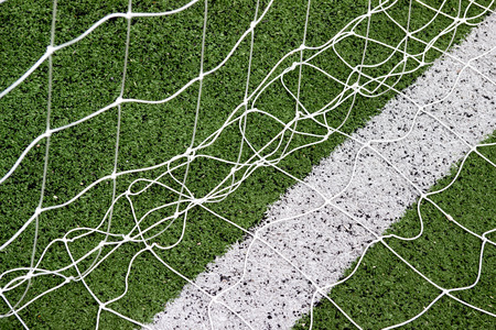arbitrate: Soccer Goal Net with the Green Grass